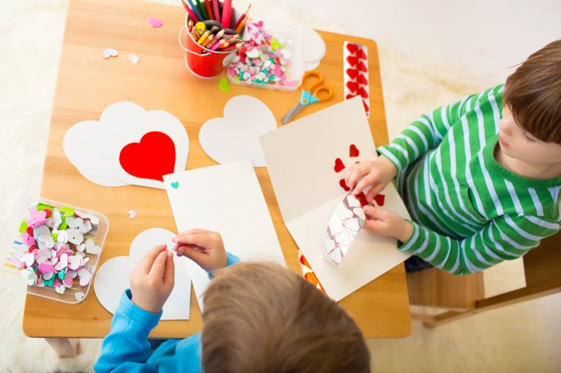 Aerial view of kids making Valentine's Day cards